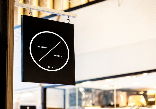 Black sign mockup outside a shop Free Psd