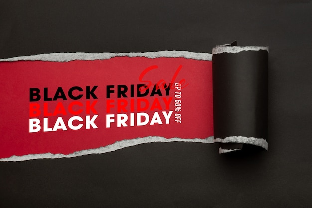 Black torn paper and the text black friday sale mockup template Premium Psd