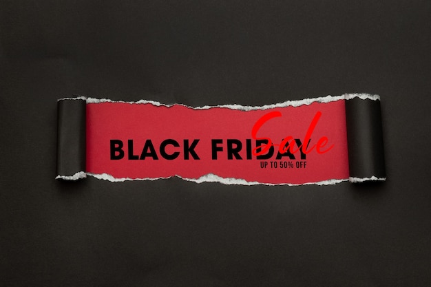 Black torn paper and the text black friday sale mockup for your design Premium Psd