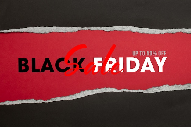 Black torn paper and the text black friday sale mockup Premium Psd