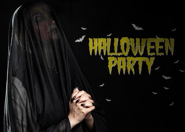Black widow with veil praying Free Psd