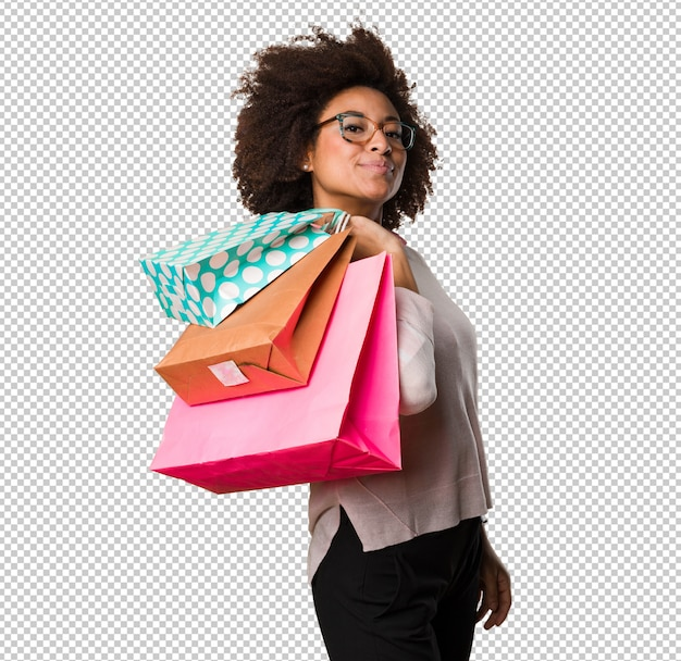 Black woman holding shopping bags Premium Psd