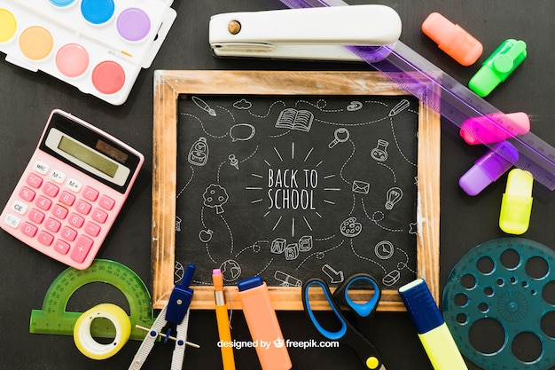 Blackboard and complete set of school materials Free Psd