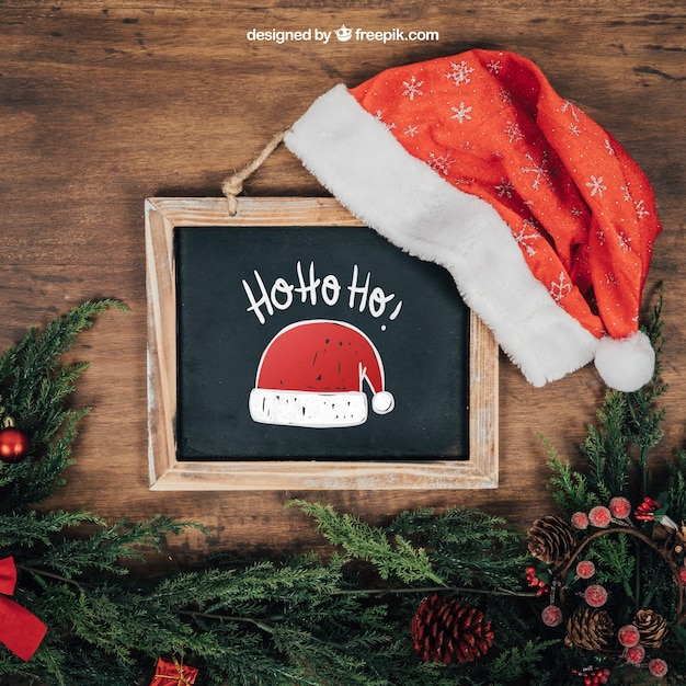 Blackboard and santa hat mockup with christmtas design Free Psd