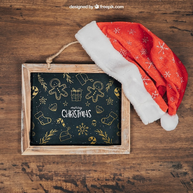 Blackboard and hat mockup with christmtas design Free Psd