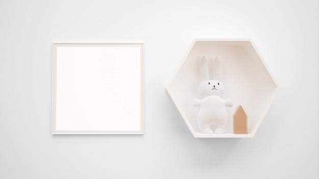 Пустой макет фоторамки висит на стене рядом с игрушкой зайчика Бесплатные Psd