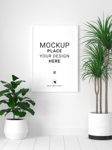 白い壁の背景の植物と空白のフォトフレームモックアップ。 Premium Psd