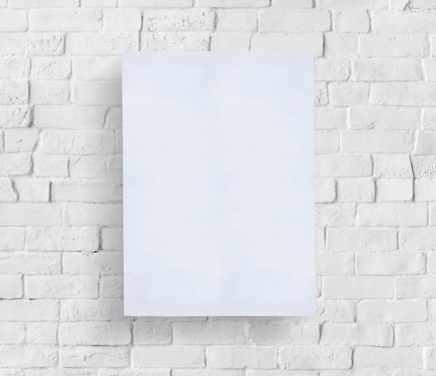 blank poster in front of brick wall psd file free download