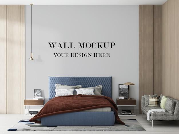 3dレンダリングで青いベッドの後ろの空白の壁 Premium Psd