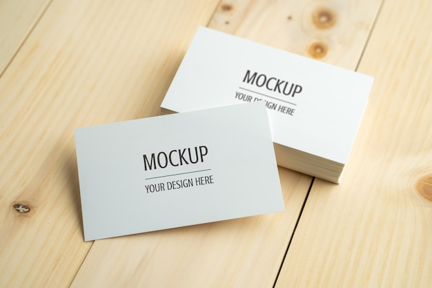 Blank white business card on wood table Premium Psd