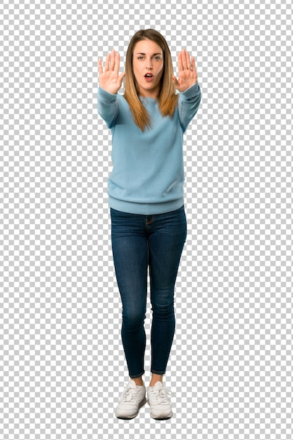 Blonde woman with blue shirt making stop gesture for disappointed with an opinion Premium Psd