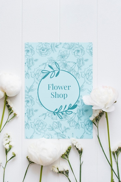 Blue flower shop mock-up and white flowers Free Psd