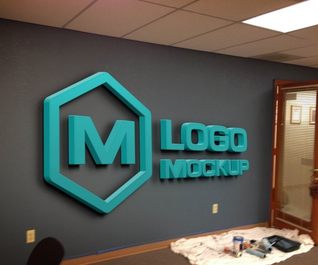 Blue Logo Mock Up On Painted Wall PSD File Free Download