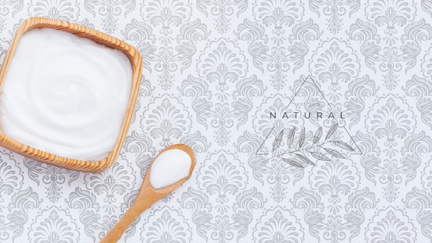Body butter cream on plain background mock-up Free Psd