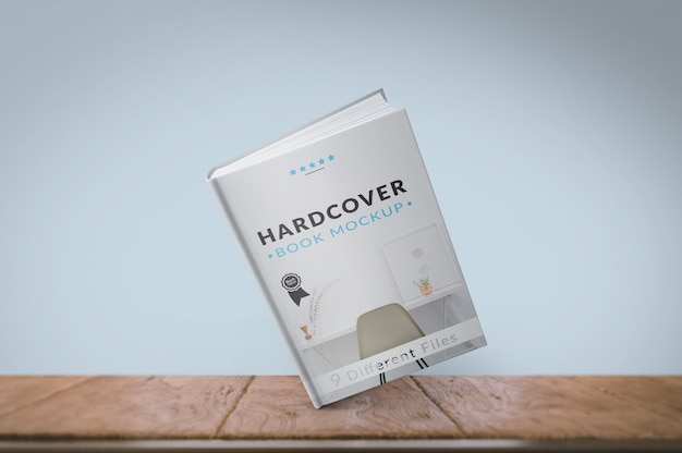 Book cover on wooden floor mock up Free Psd