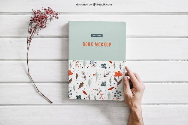 Book mock up with flower Free Psd