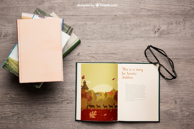 Book mockup with reading glasses Free Psd