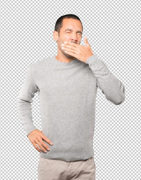Скучно молодой человек зевая жест Premium Psd