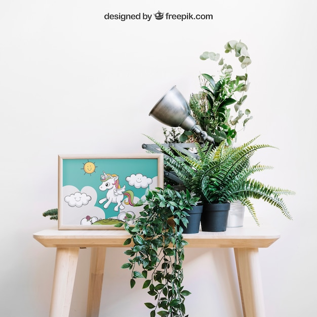 Botanical mockup of frame on chair Free Psd