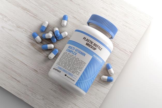 Бутылка с таблетками на деревянной поверхности макета Premium Psd
