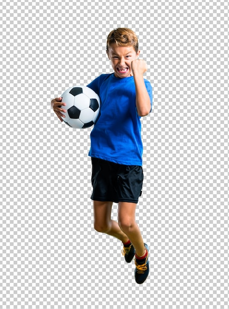 Boy playing soccer and jumping Premium Psd