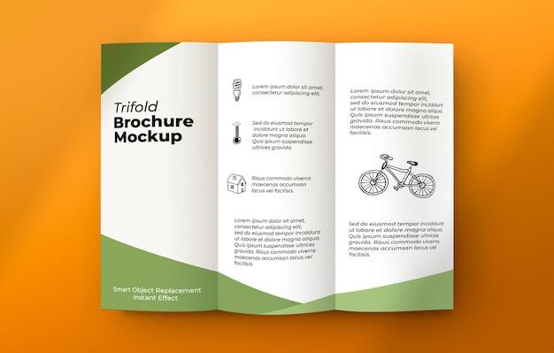 Brochure on grey surface mockup Free Psd