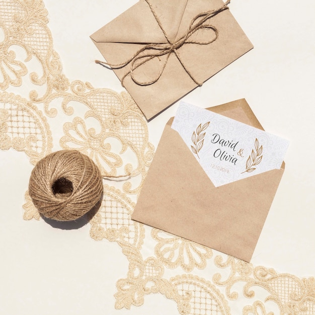 Brown paper envelopes on embroidery fabric Free Psd