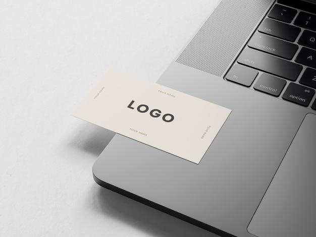 Business card on laptop Premium Psd