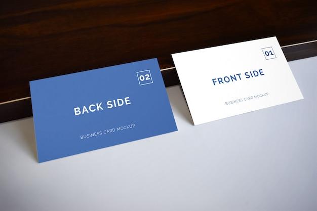 Business card laying on wood mockup Premium Psd