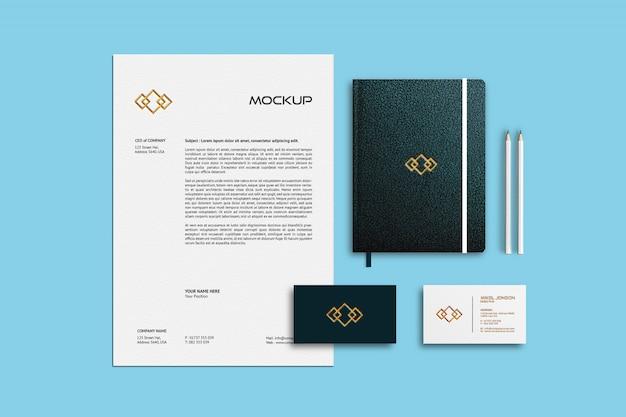 명함, 레터 헤드 및 노트북 모형 프리미엄 PSD 파일