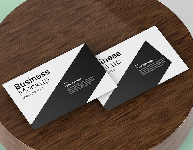 Business card mock-up on wooden board Free Psd