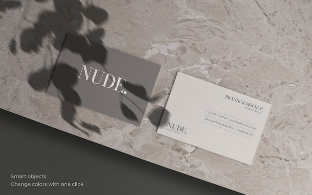 Business card mockup with botanical shadow and marble texture Free Psd