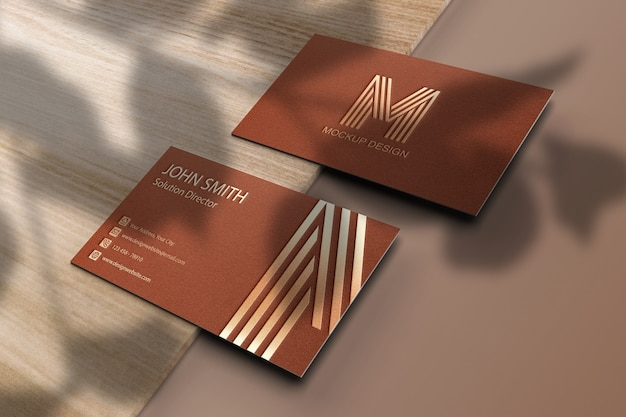 Business card mockup with leaves shadow overlay Premium Psd
