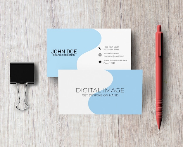 Business card mockup with pen and binder clip Premium Psd