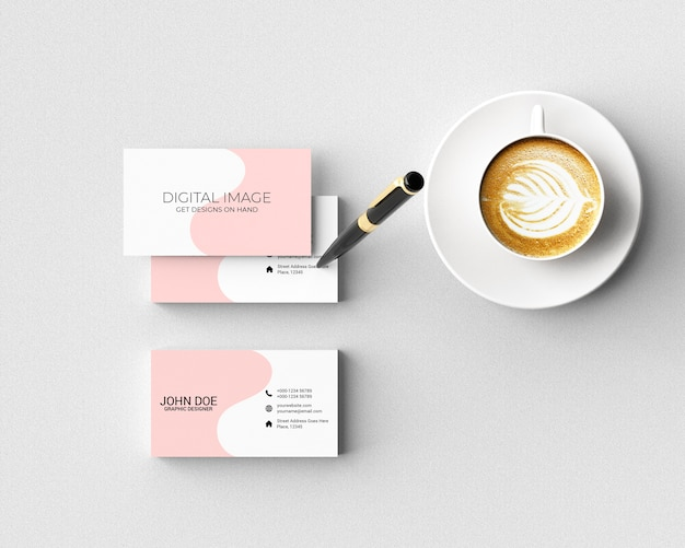 Business card mockup with pen and coffee Premium Psd