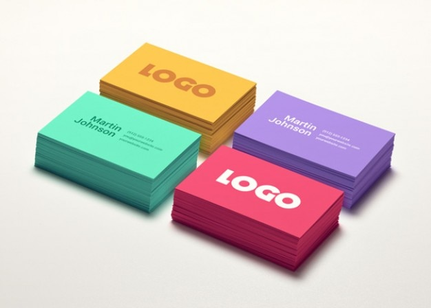 Business card mockups in four colors Free Psd
