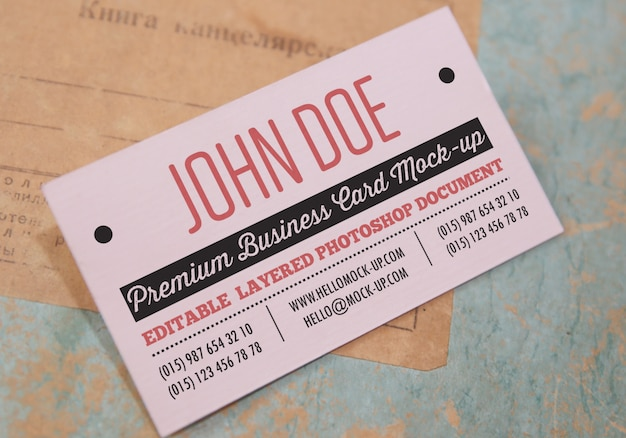 Business card on old papers and envelopes