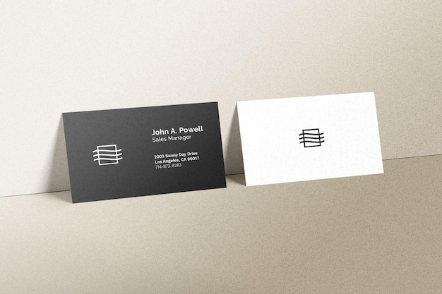 Business cards laying on a wall mockup Free Psd