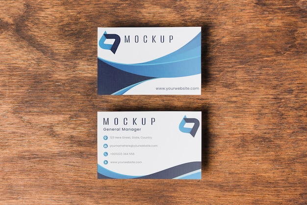 Business cards on wooden background top view Free Psd