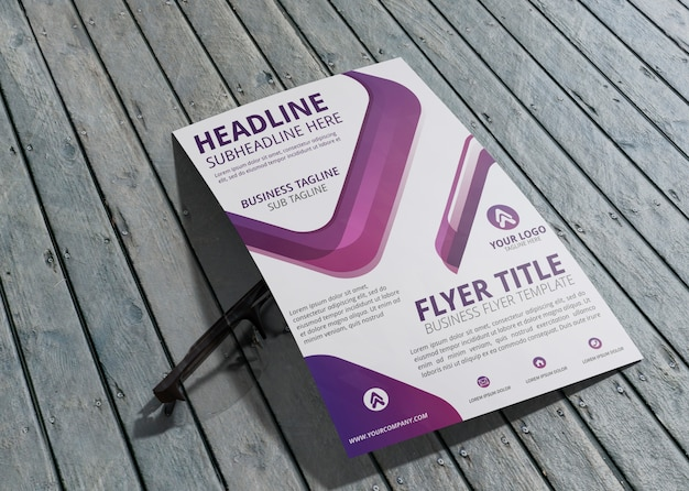 Business corporate identity template for flyer on wooden background Free Psd