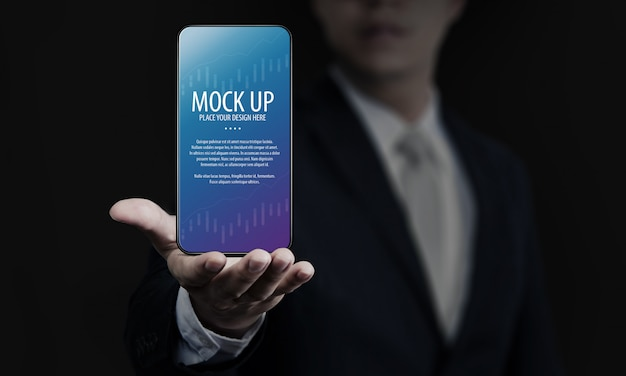 Business man holding smartphone screen mock-up Premium Psd