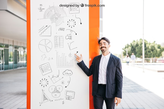 Business mockup with smiling man Free Psd