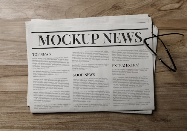 Business newspaper mockup template with glasses Premium Psd