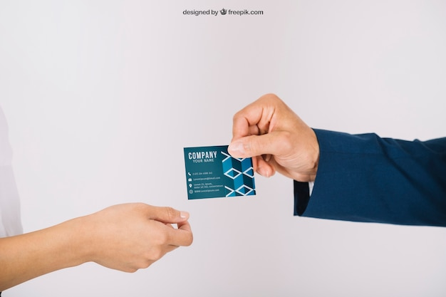 Business persons exchanging business card Free Psd