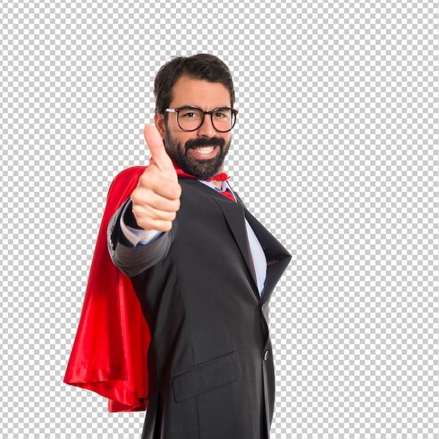 Businessman dressed like superhero with thumb up Premium Psd