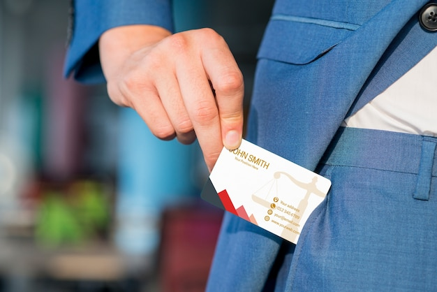 Businessman pulling out business card mockup Free Psd