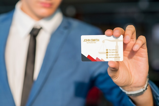 Businessman showing business card mockup Free Psd