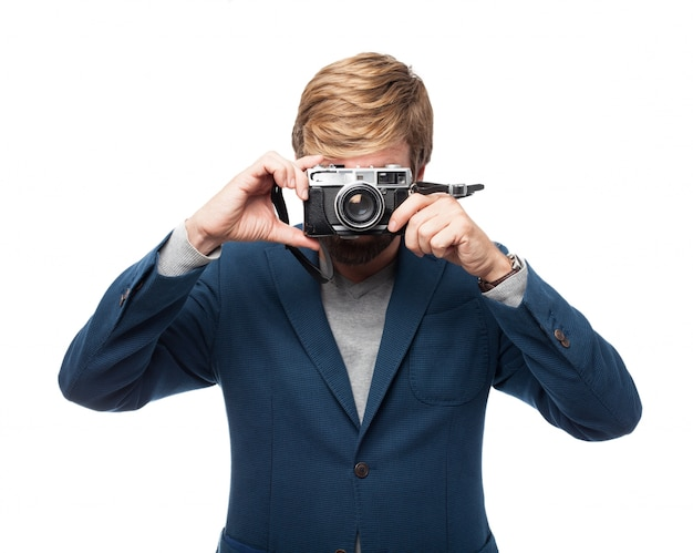Businessman taking a picture with a vintage camera Free Psd