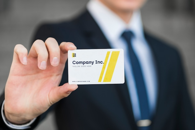 Businessman with business card mockup Free Psd