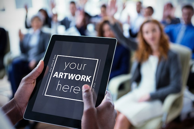 Businessperson using digital tablet during meeting Premium Psd
